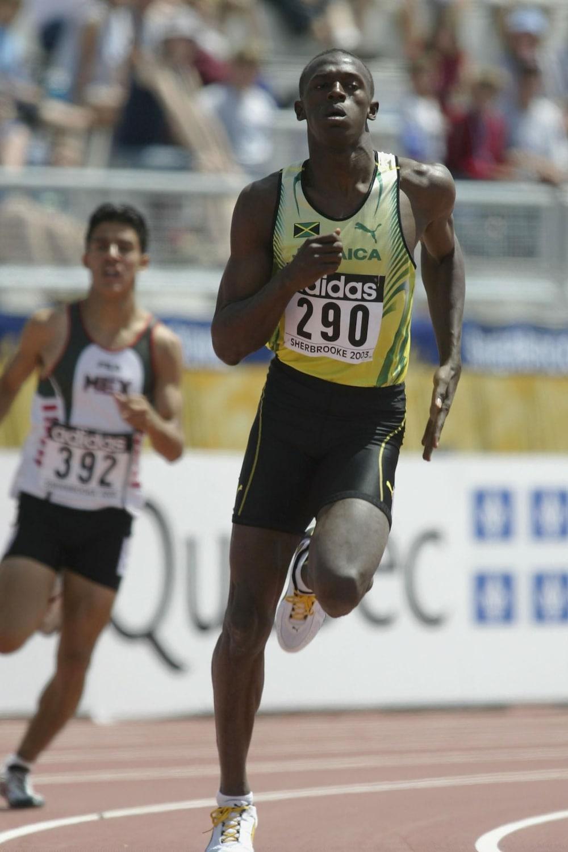 Usain Bolt (en jaune) le 10 juillet 2003 dans sa vague de qualifications du 400 m aux Championnats du monde jeunesse de Sherbrooke