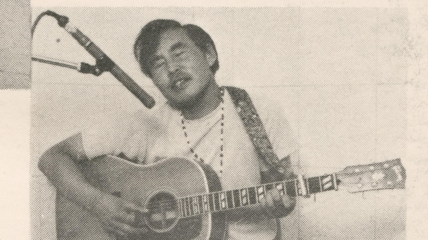 John Angaiak playing the guitar.