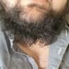La partie basse du visage de la victime avec une barbe coupée.