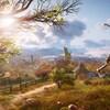 Capture d'écran d'un jeu vidéo montrant un guerrier viking en haut d'une montagne gazonnée, avec une vue sur un village.