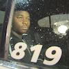 Blessing Dugbeh dans une voiture de police