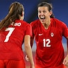 Canadian Christine Sinclair, right, celebrates Canada's gold-medal victory over Sweden with teammate Julia Grosso Friday in Tokyo.