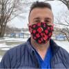 Le Dr Hassan Masri de face, portant le masque.