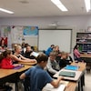 Des élèves dans une classe de l'École Ducharme à Moose Jaw, en Saskatchewan