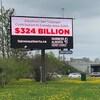 Un panneau publicitaire de Fairness Alberta.