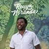 Un homme sourit en regardant au loin sur la couverture d'un guide intitulé Bienvenue à Rouyn-Noranda.
