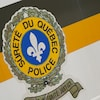 Le logo de la Sûreté du Québec sur un véhicule.