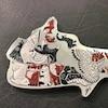 Une pièce de monnaie qui a la forme géographique du Canada et dont les provinces sont formées par des animaux de la faune canadienne.