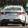 Trois véhicules de la police de Saskatoon.