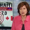 Céline Galipeau devant une mortaise illustrant la magnitude 7 du séisme en Haïti.