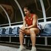 Bianca Farella membre de l'équipe canadienne de Rugby assise sur un banc.