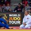 Jessica Klimkait (en blanc) agenouillée sur un tatami face à son adversaire.