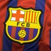 Logo du club sur un maillot.