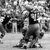Le botteur des Saints, portant le numéro 19, s'élance pour tenter un placement dans un match contre les Lions de Détroit en 1970.