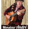 L'artiste habillé en chemise carreautée et chapeau de poil qui joue de la guitare