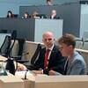 Le député fédéral Randy Boissonnault et la députée provinciale Janis Irvin sont assis dans la salle du conseil municipal.