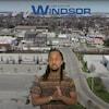 Muco Habimana devant une image aérienne de Windsor.