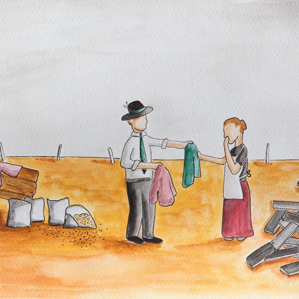 Un homme remet des vêtements à une femme.