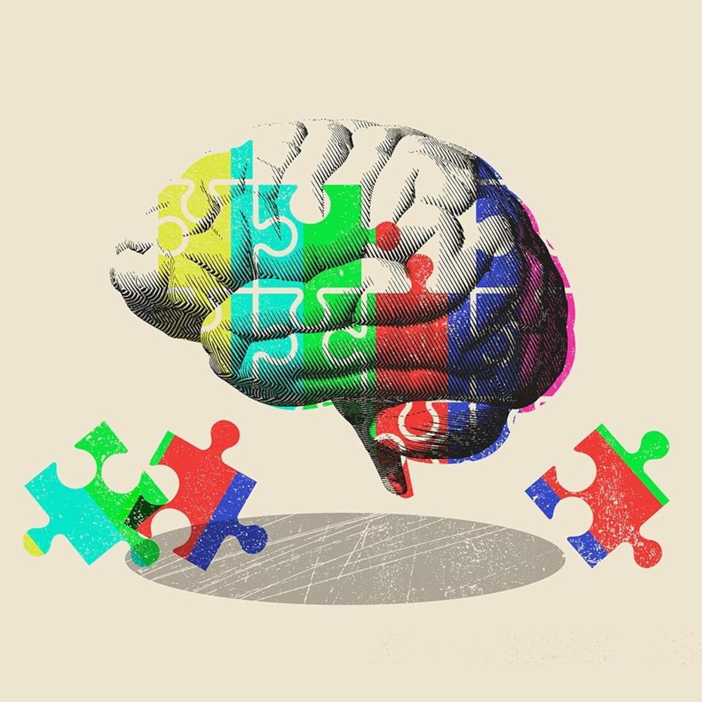 Infographie où des pièces de casse-tête sont superposées à l'image d'un cerveau.
