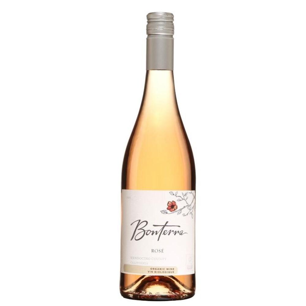 Bouteille de vin rosé avec un dessin de branche fleurie.