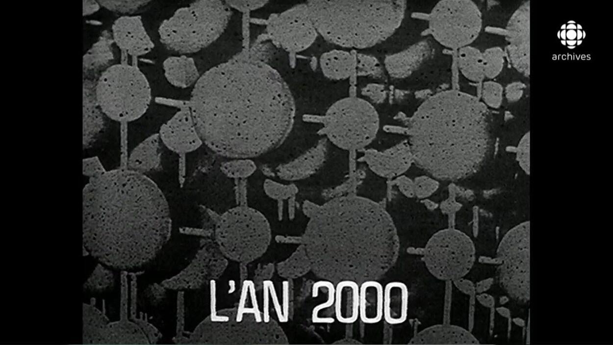 Illustration d'atomes groupés avec au bas le titre « L'AN 2000 ».