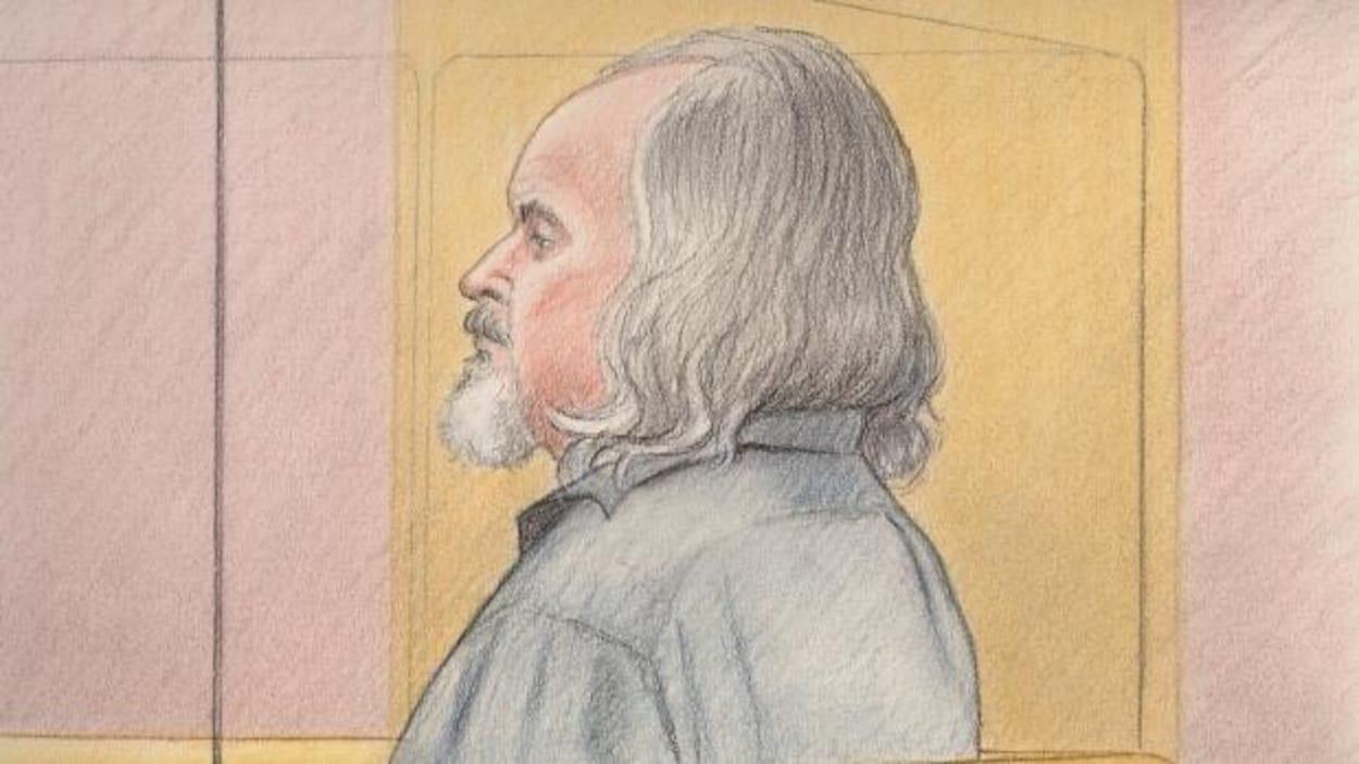 Basil Borutski vu de profil dans le box des accusés au palais de justice d'Ottawa.