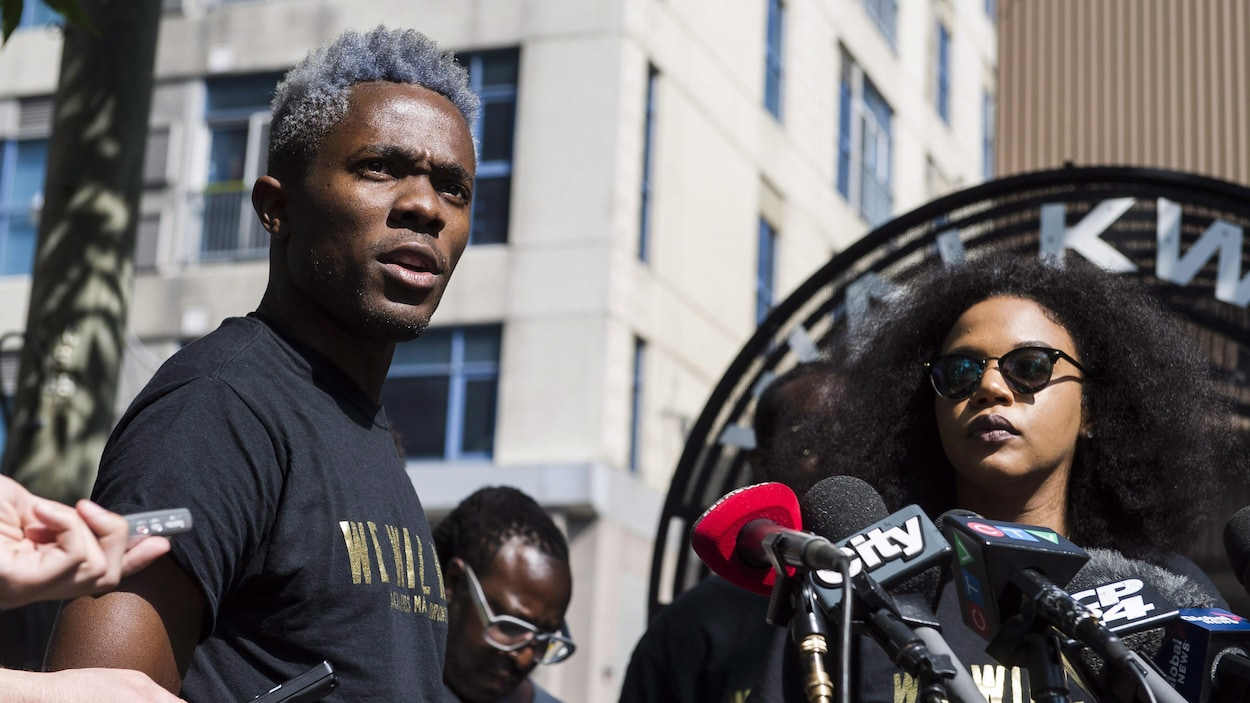 Rodney Diverlus, left, of Black Lives Matter Toronto, speaks at a news conference to discuss the Pride Parade controversy in Toronto on Thursday July 7, 2016. THE CANADIAN PRESS/Christopher Katsarov