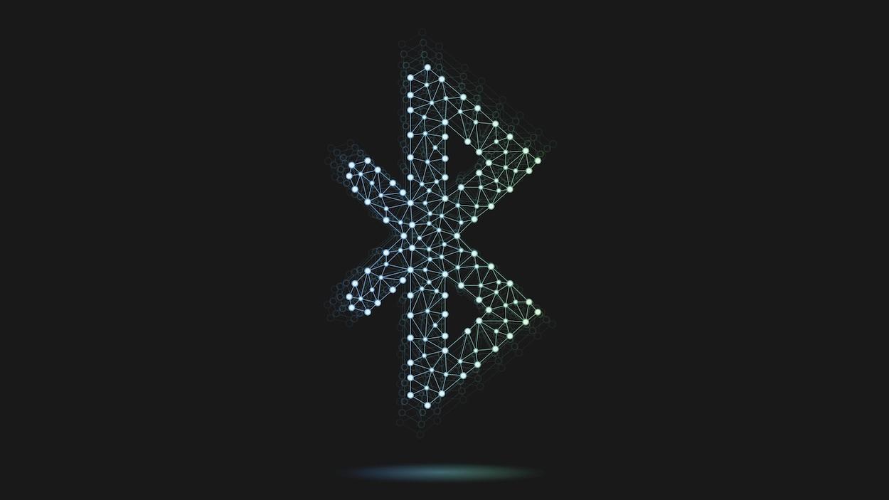 Le logo de Bluetooth stylisé en plusieurs points de lumière reliés entre eux sur fond noir.