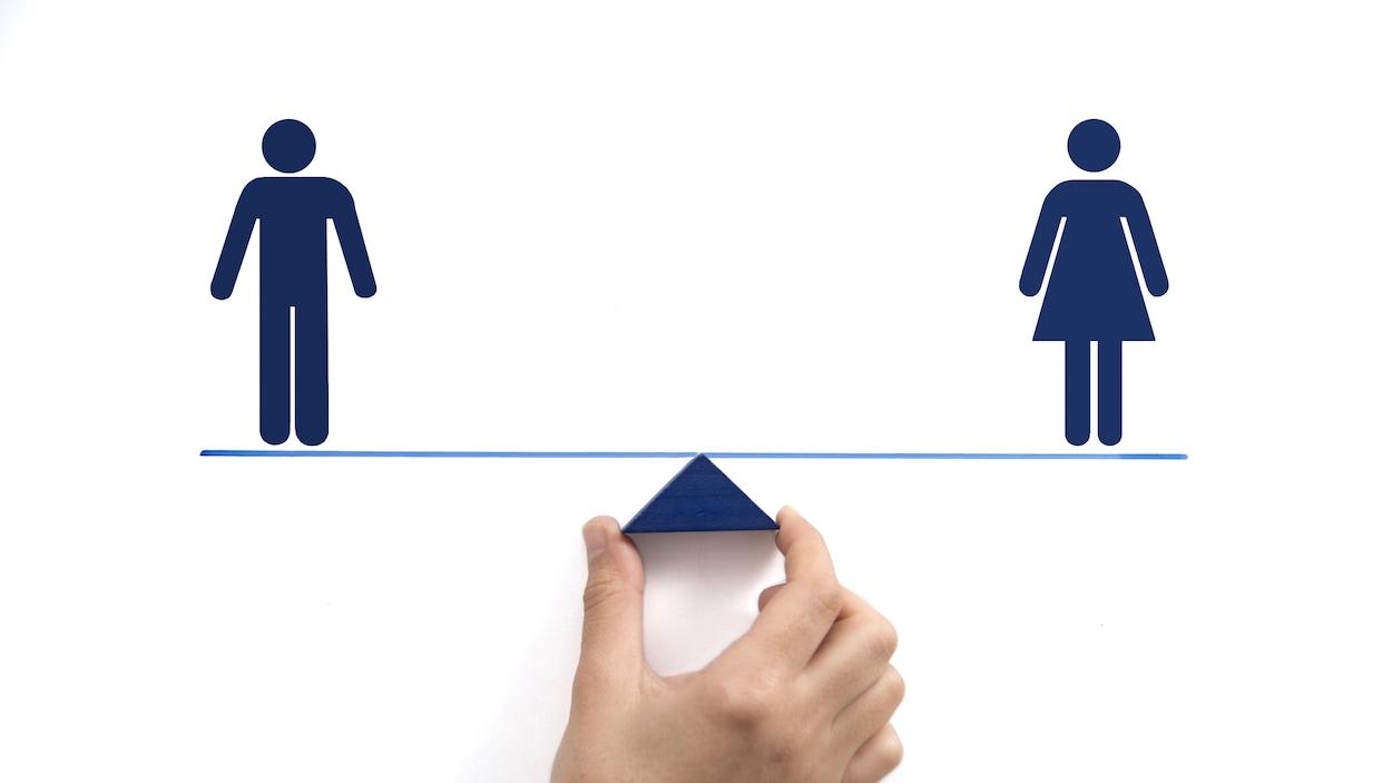 Un dessin représente un homme et une femme qui se tiennent de chaque côté d'une balance.