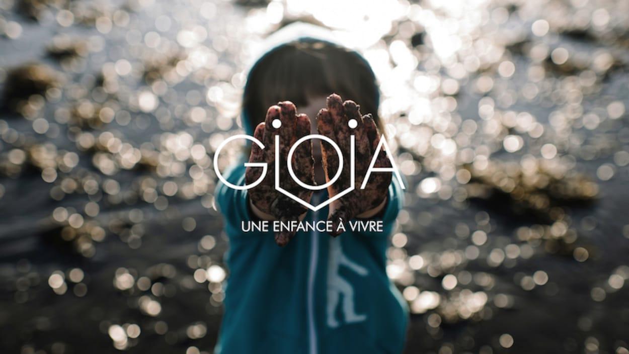Le logo des Enfants GIOIA : un enfant qui montre ses mains
