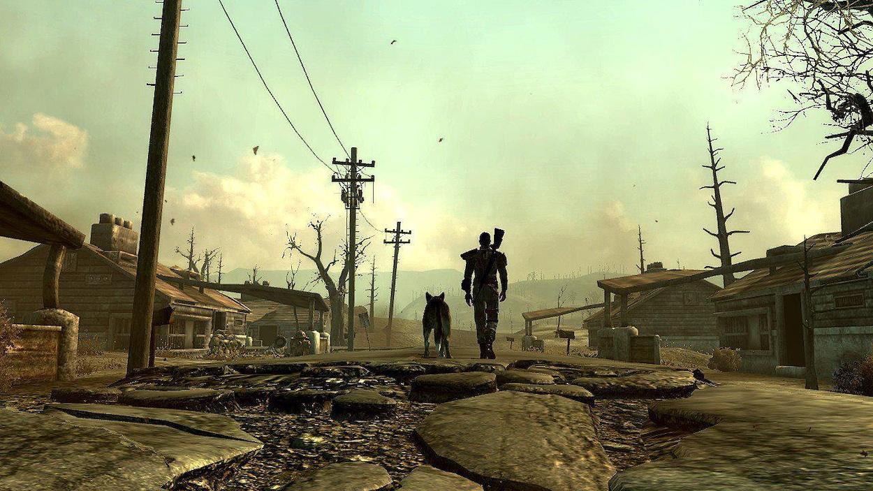 Un homme avec un fusil au dos et un chien marchent, vus de dos, dans un univers post-apocalyptique.