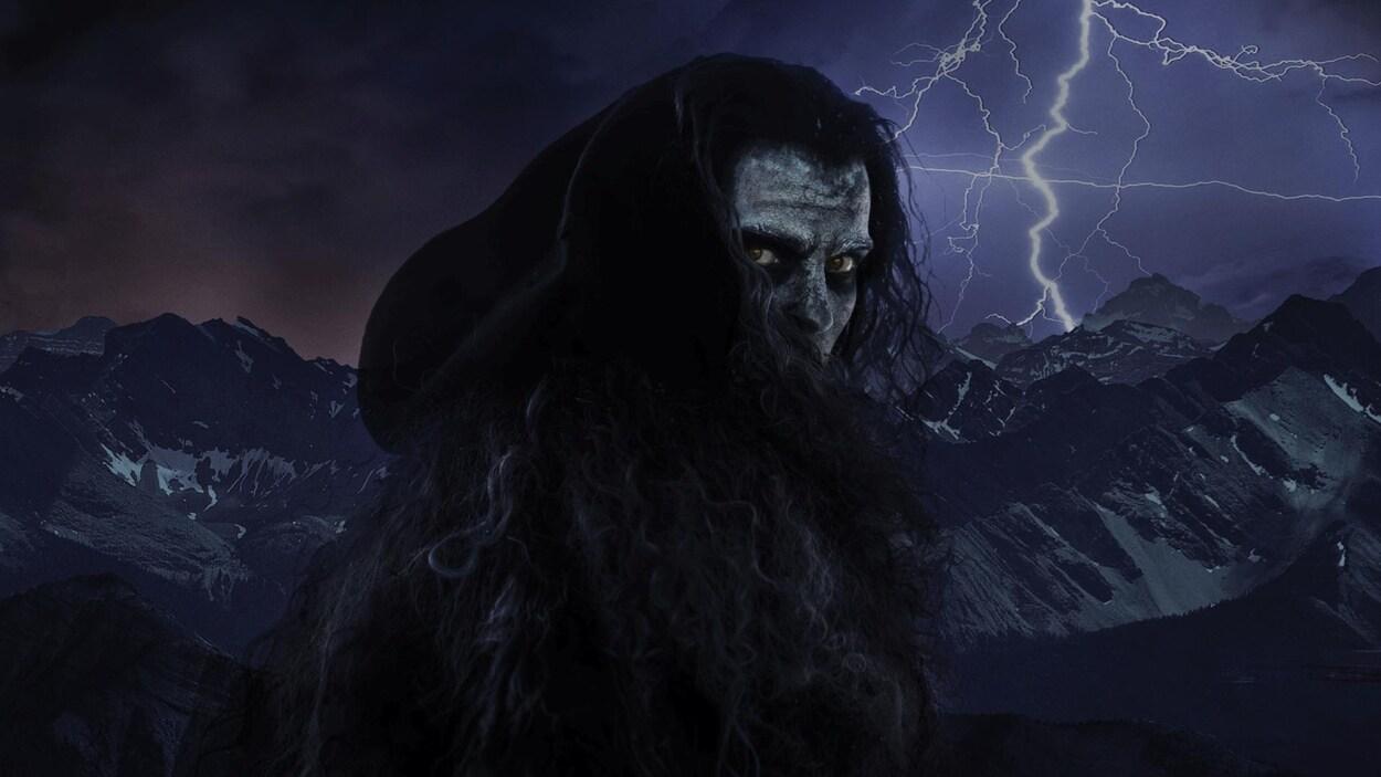 L'image d'un homme monstre devant une chaîne de montagnes et un éclair.