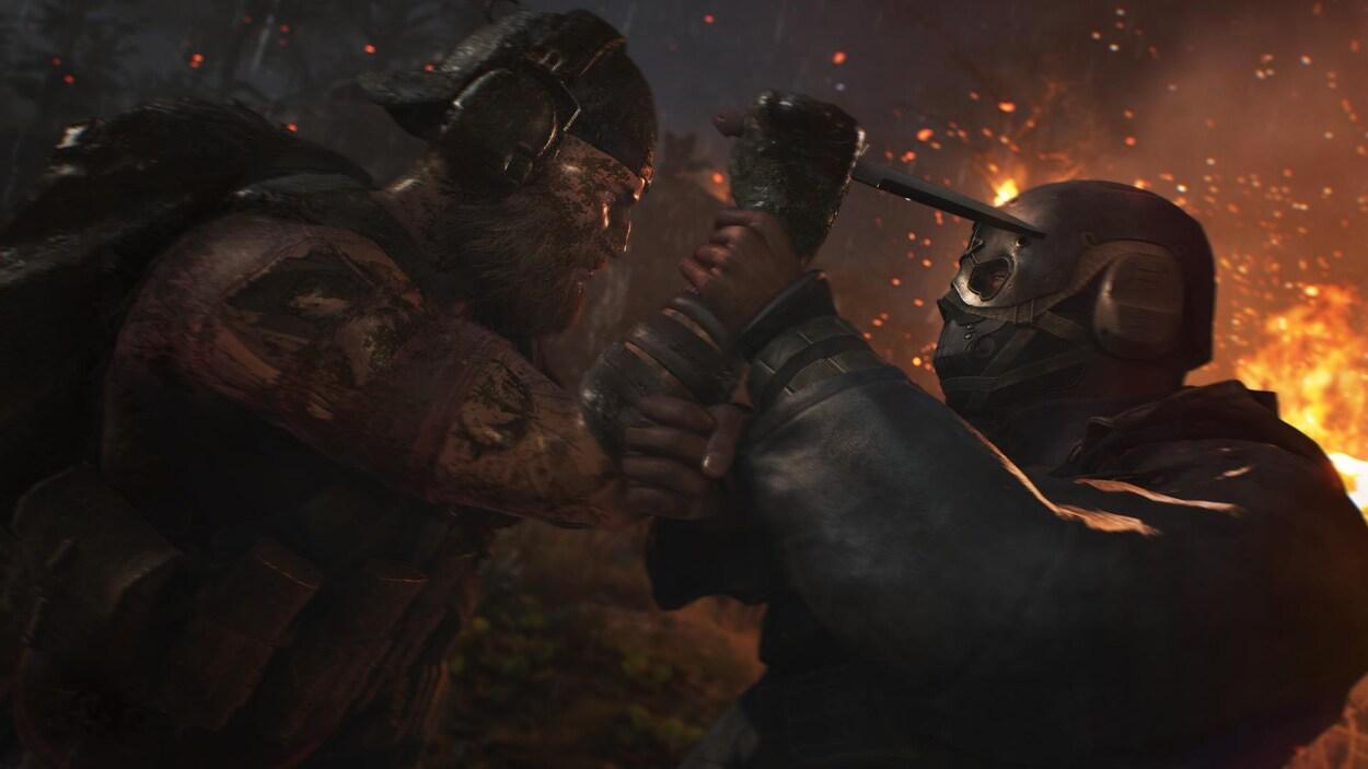 Une capture d'écran montrant un homme musclé et barbu en train de se battre avec un autre personnage masqué. L'homme barbu tente de poignarder le second.