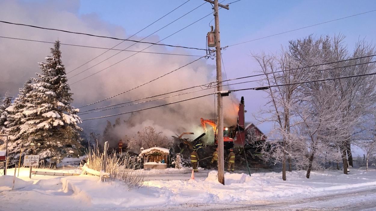 La maison ravagée par les flammes.