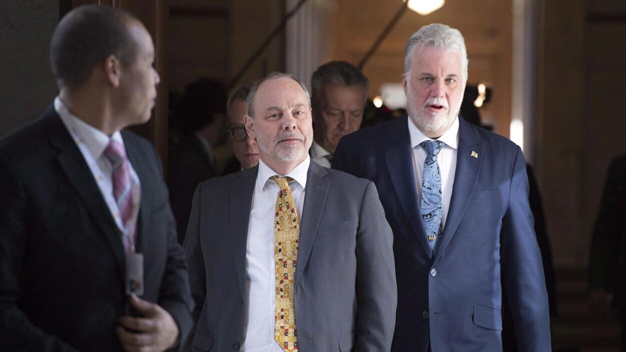 Le premier ministre Philippe Couillard et son chef de cabinet, Jean-Louis Dufresne
