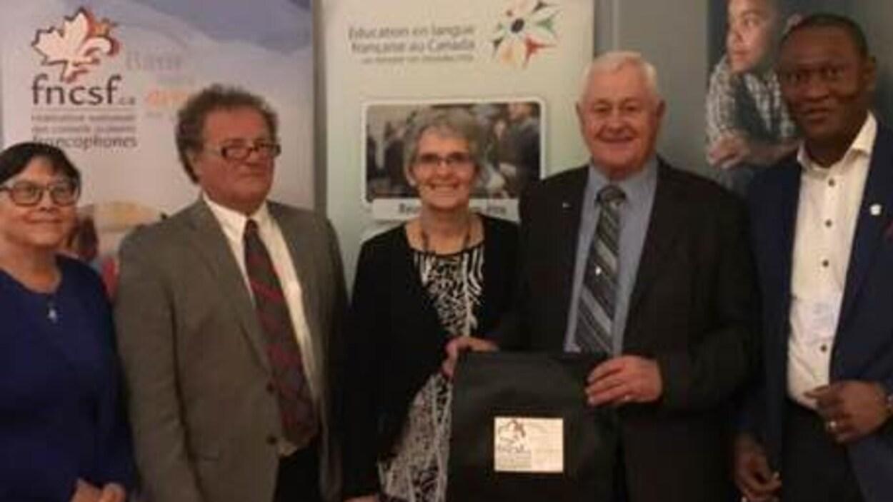 Un montage de trois photos prises lors du congrès annuel de la Fédération nationale des conseils scolaires francophones, à Halifax, en Nouvelle-Écosse.