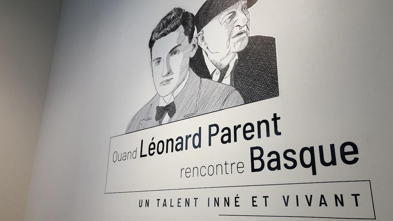 Affiche à l'entrée d'une exposition sur laquelle on peut lire « Quand Léonard Parent rencontre Basque : un talent inné et vivant ».