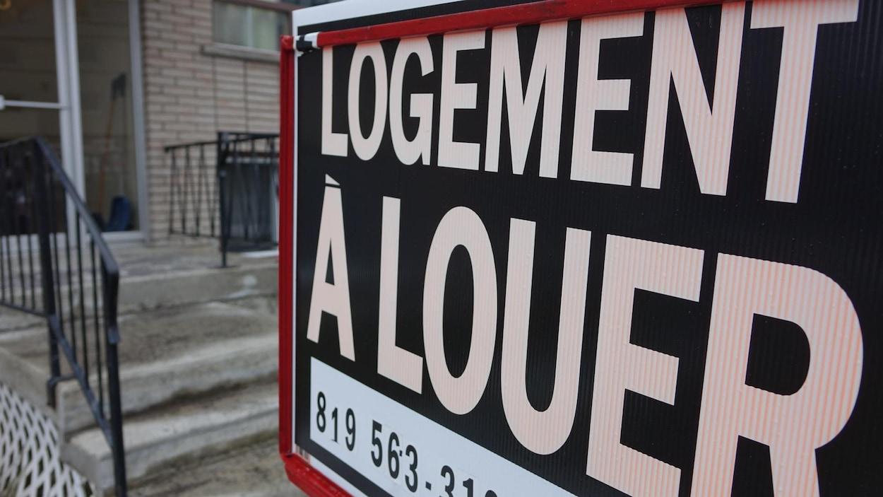 Une pancarte de logement à louer.