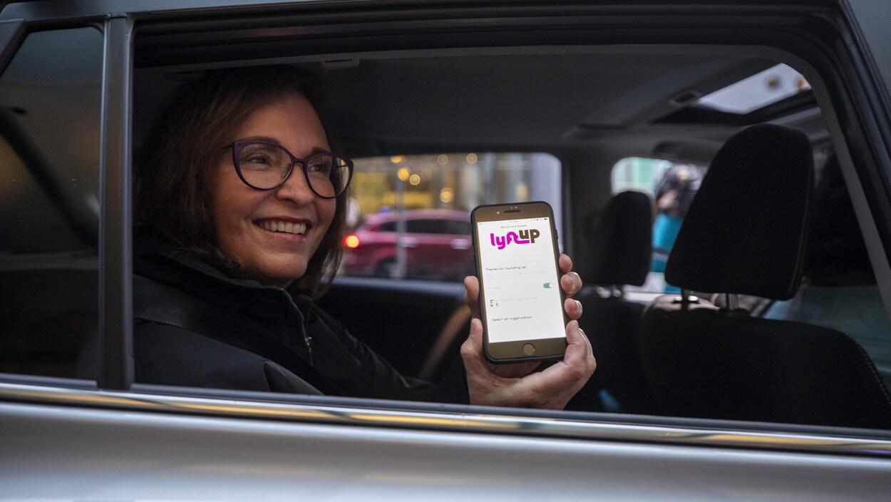 Une cliente effectue le premier trajet Lyft à Vancouver, en Colombie-Britannique.