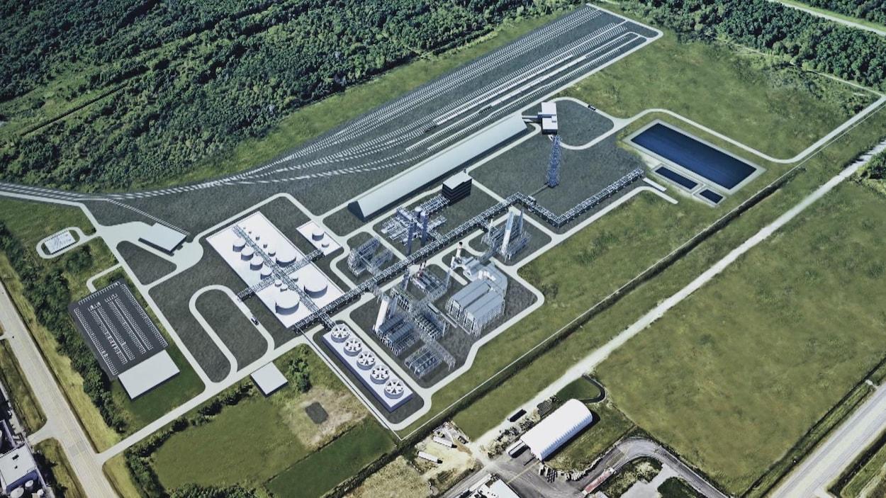 Image d'une vue aérienne du projet où on voit des bâtiments et des arbres