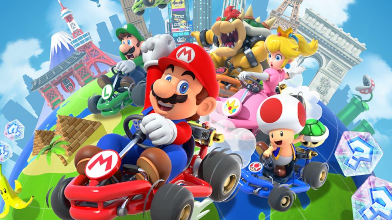 Les personnages Lugi, Mario, Bowser, Peach, Toad et Yoshi dans des karts.