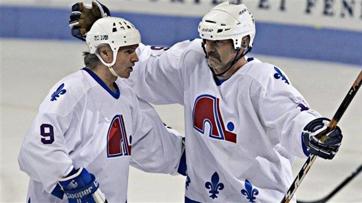Réal Cloutier et Michel Goulet (à droite).