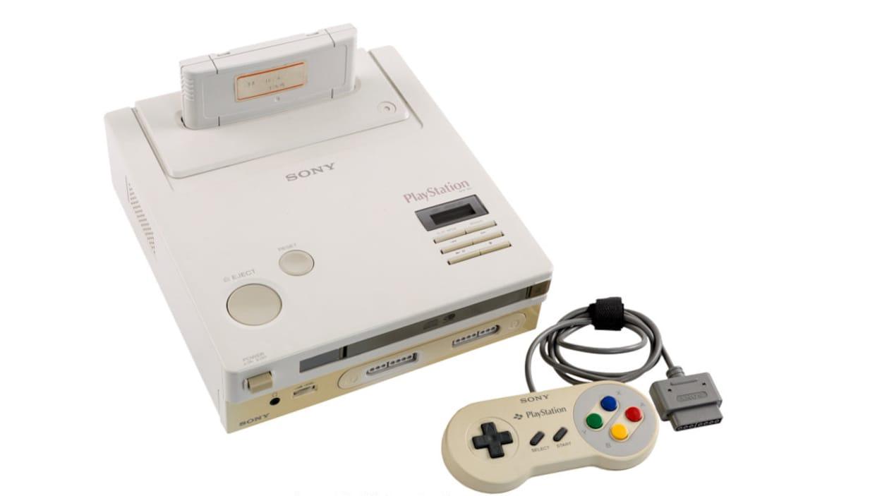 Une console Nintendo Playstation accompagnée d'une manette ressemblant à celle de la Super Nintendo.