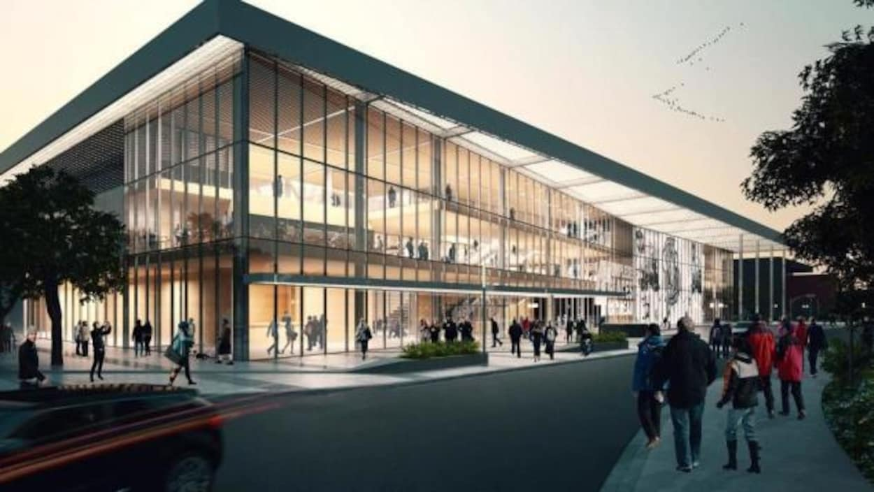 Un édifice de plusieurs étages rectangulaire dont la facade est complètement vitrée.