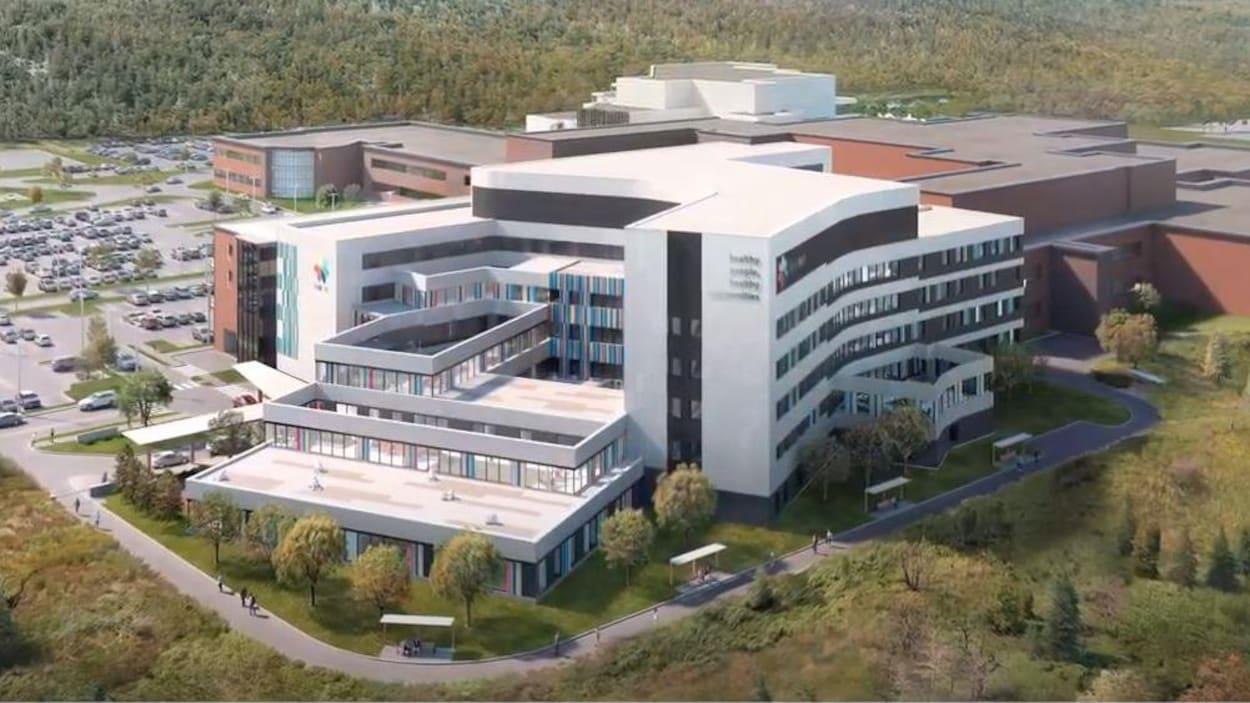 Une image d'un hôpital et d'un stationnement.