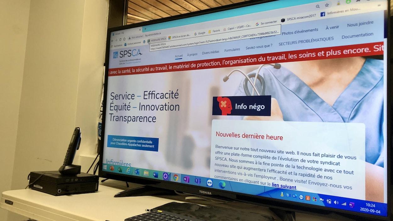 Un écran d'ordinateur affichant le site Internet du Syndicat des professionnelles en soins de santé de Chaudière-Appalaches,
