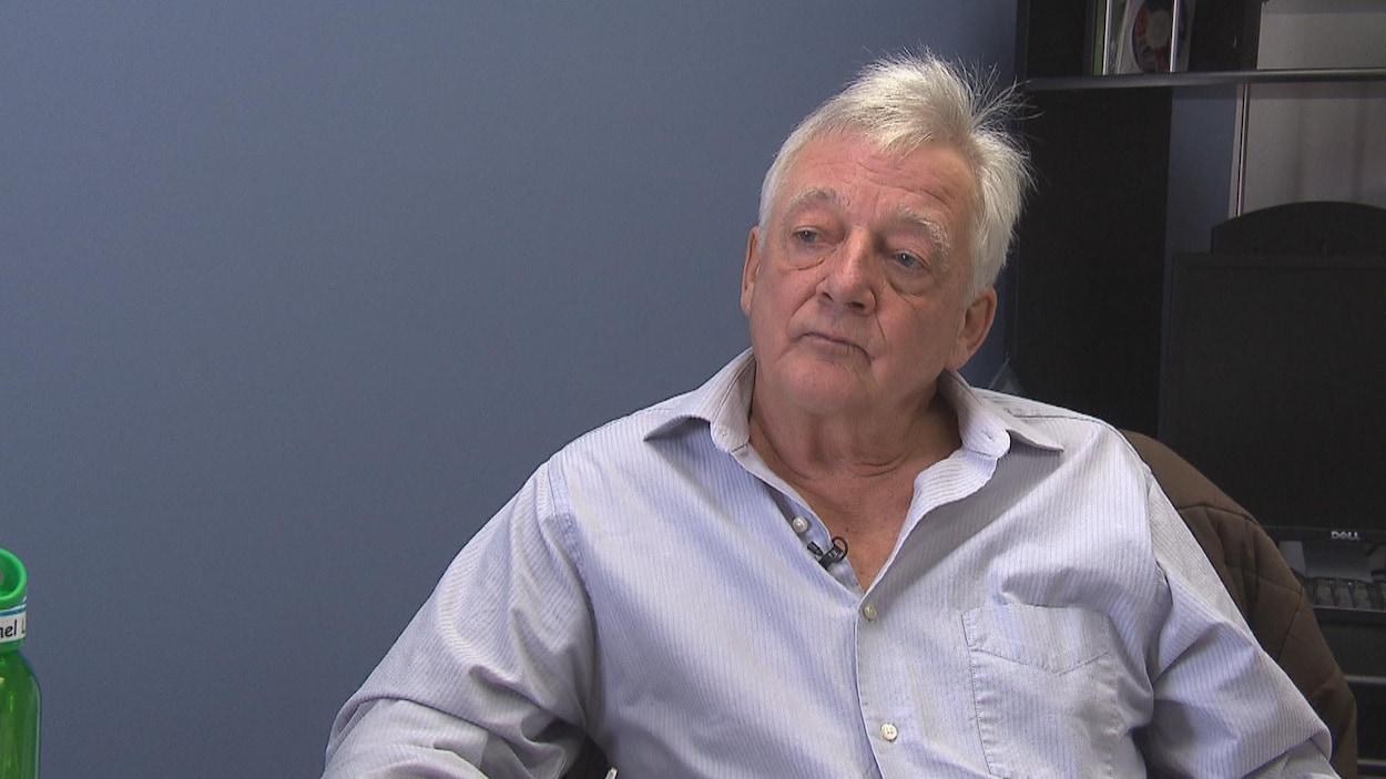 Michel Lemay assis dans son bureau