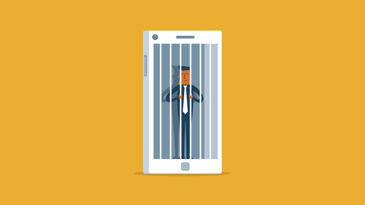 Une image montrant un téléphone intelligent dans lequel se tient un personnage qui s'agrippe à des barreaux de prison.