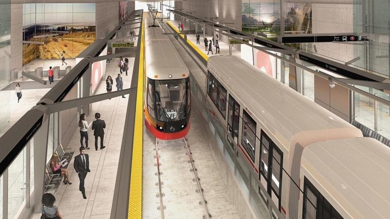Une vue surplombante de l'intérieur d'une station avec deux trains.