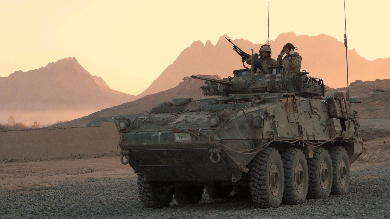 A Canadian LAV (light armoured vehicle) arrives to escort a convoy at a forward operating base near Panjwaii, Afghanistan at sunrise on Nov.26, 2006. The Canadian Press has learned that Canada's foreign ministry is closely monitoring all of the country's military exports, but won't revisit the controversial decision to allow the sale of light armoured vehicles to Saudi Arabia. THE CANADIAN PRESS/Bill Graveland